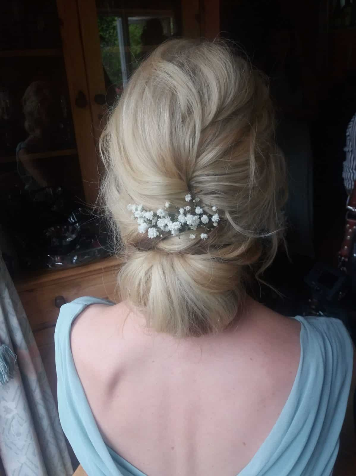 close up of low bridal chignon with gypsophila