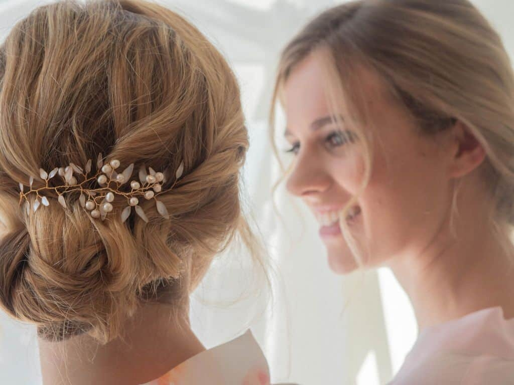 bride with boho updo and her reflection in mirror