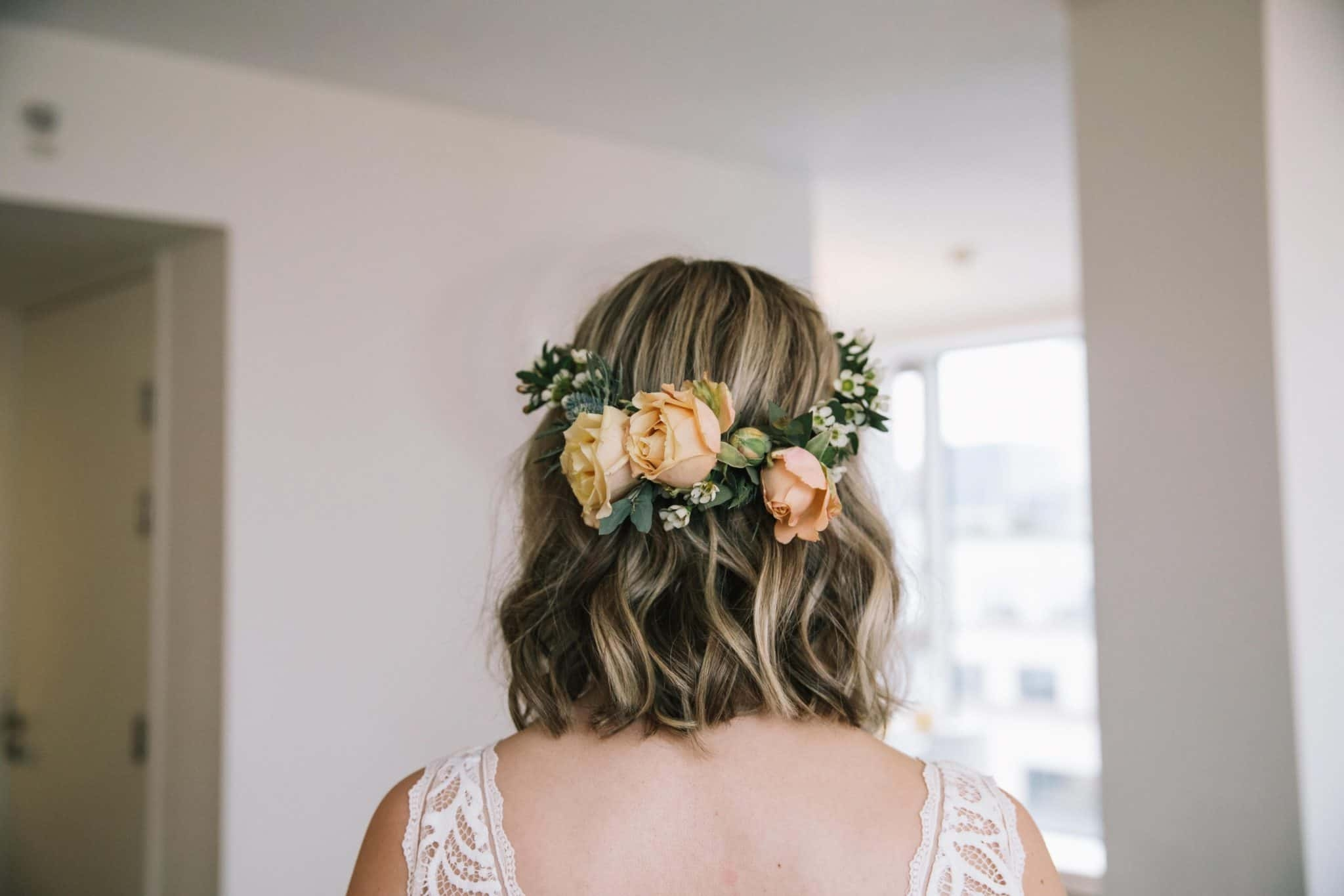 close us of back of bride's boho waves and flower crown