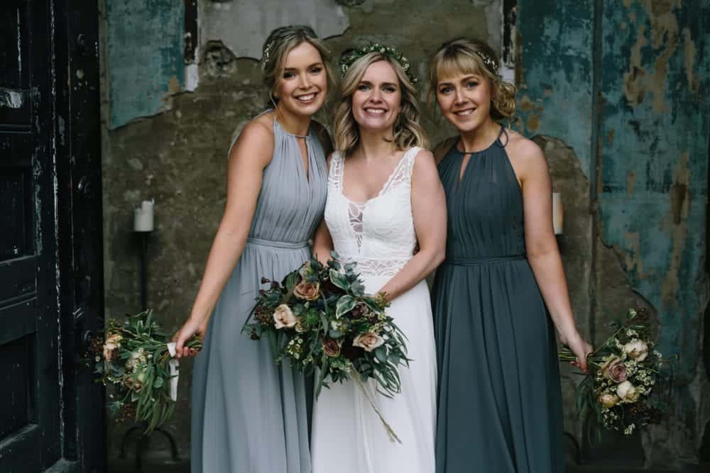 bride and her 2 bridesmaids outside the asylum in Peckham