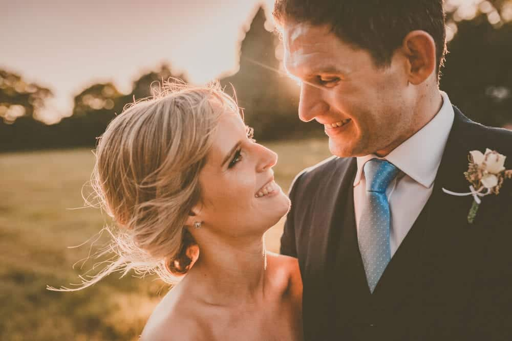 close up of happy bride and groom photographed at sunet on wedding day