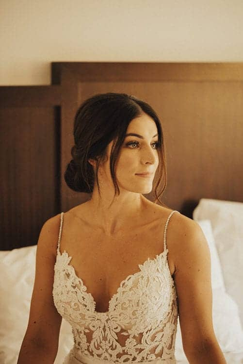 portrait of bride with low chignon wearing enzoani wedding dress