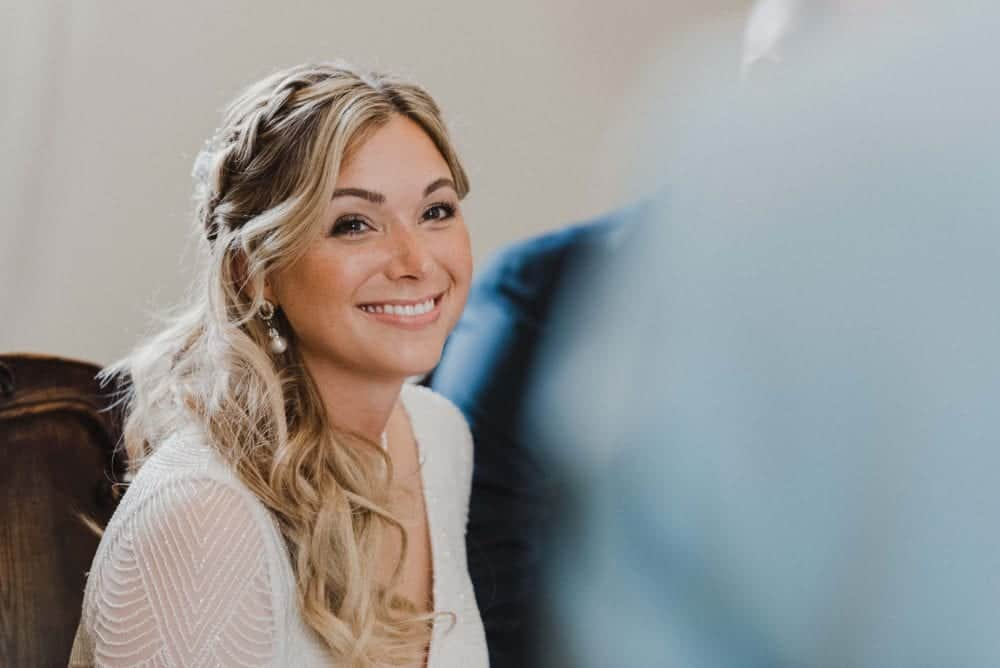 happy bride with freckles and natural makeup at her wedding ceremony