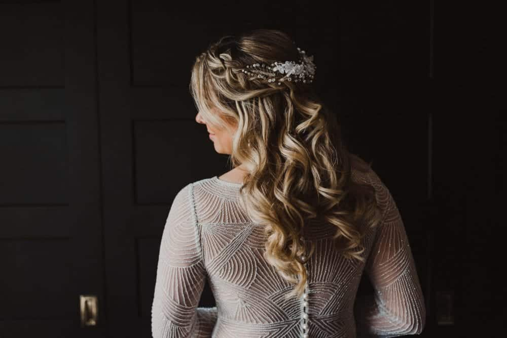 back of bride showcasing her curls and beaded wedding gown