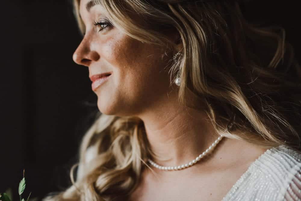close up of bride with natural makeup and pearl necklace