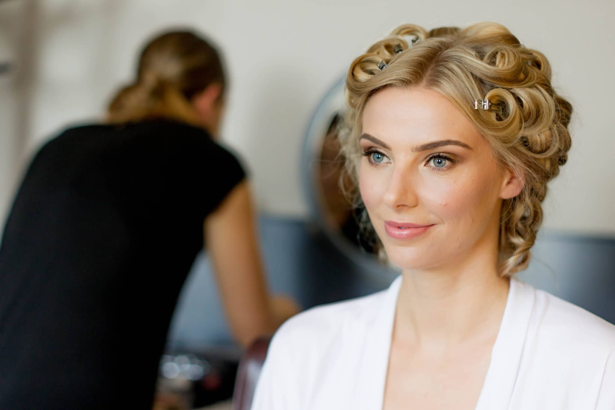 portrait of bride with hair in rollers and natural makeup
