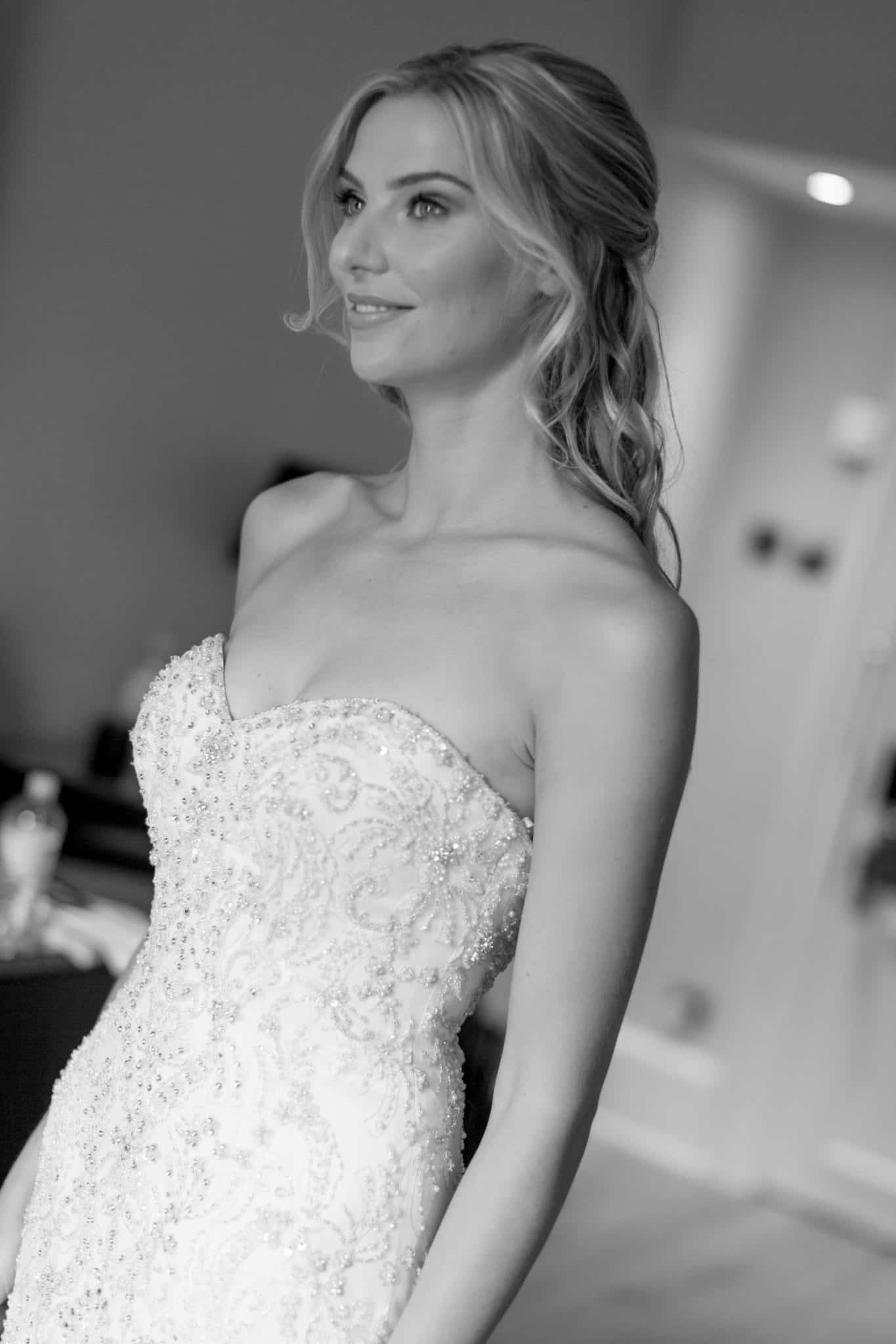 black and white portrait of bride in beaded strapless wedding dress