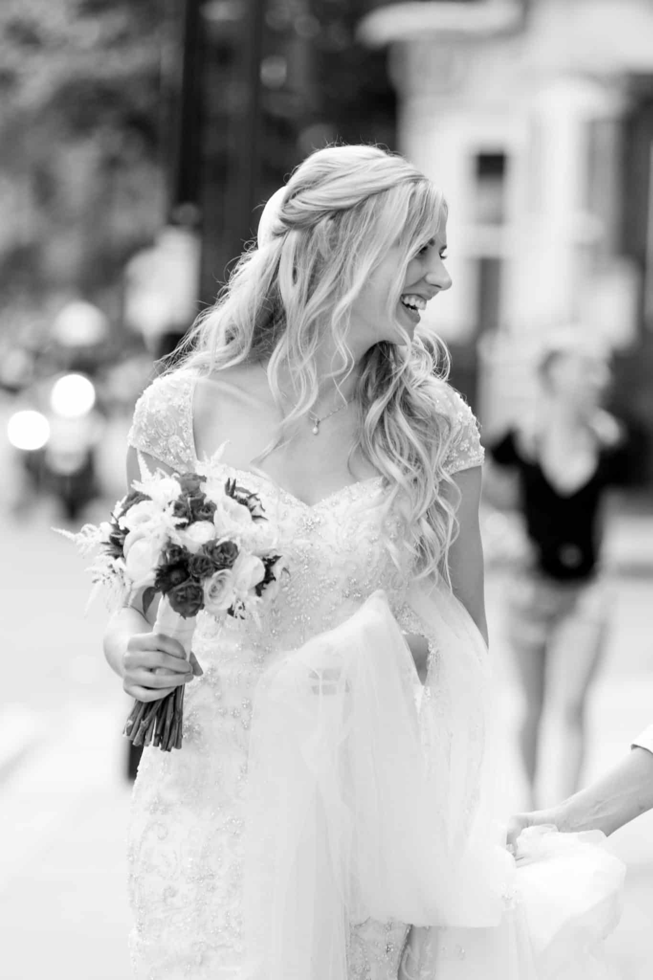 happy bride walking theough london with loose curls