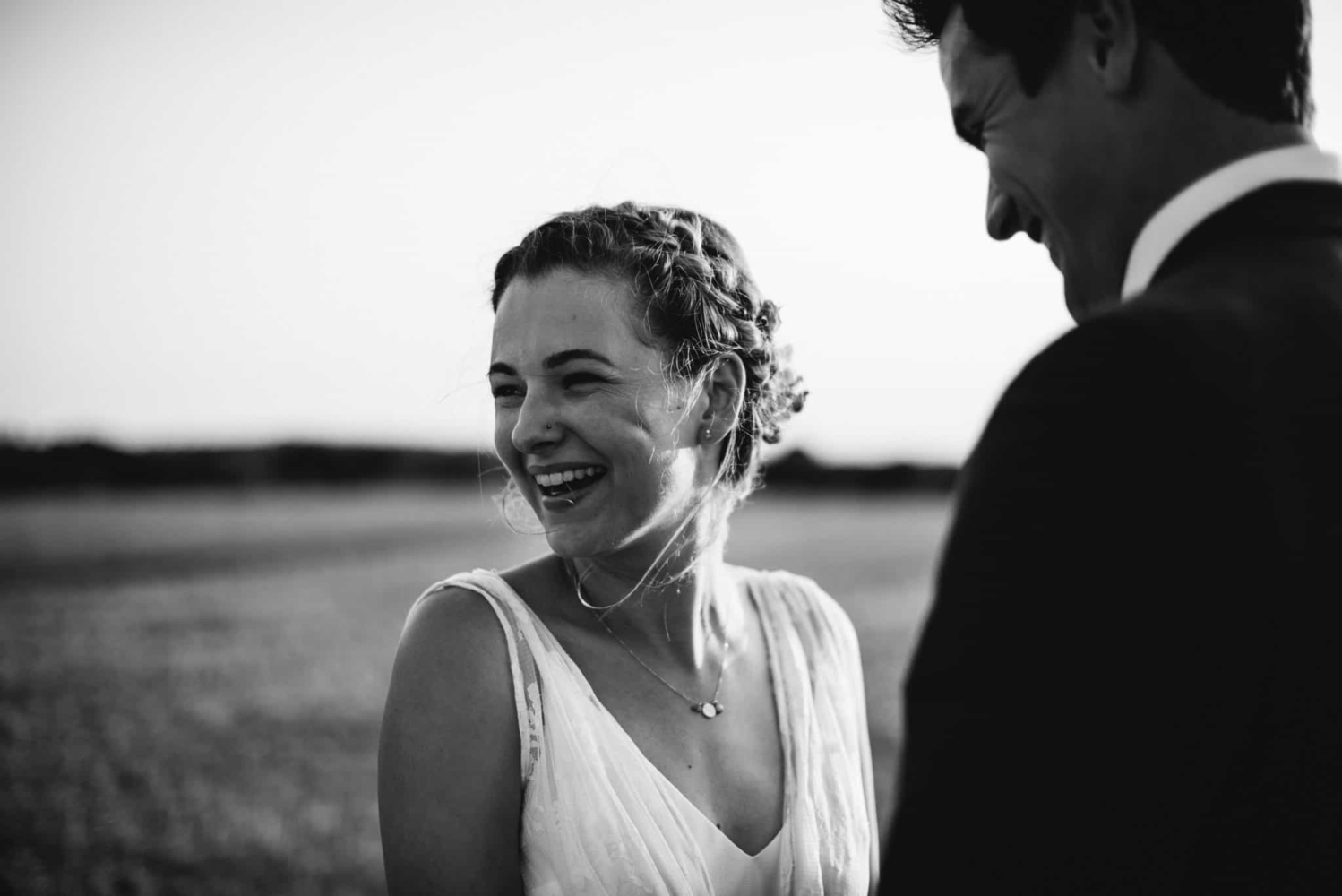 black and white photography of happy boho bride and groom