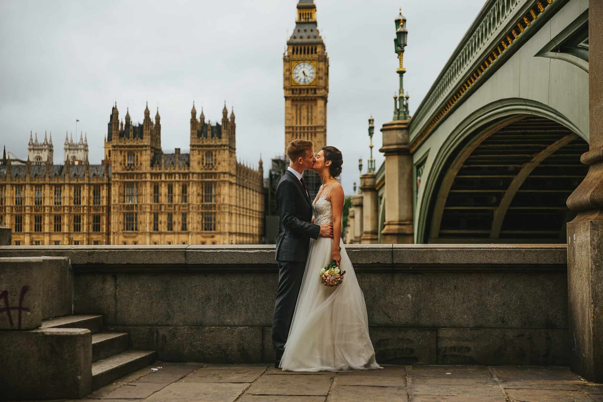 bride and groom kissing in front of big ben