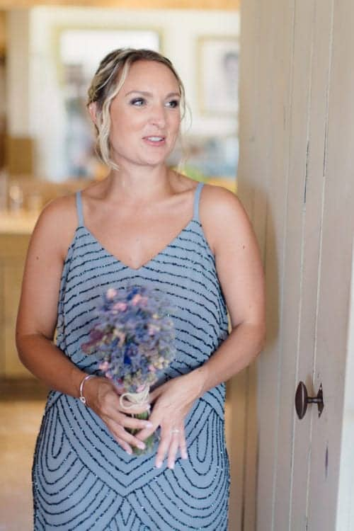 bridesmaid standing by door in chateaux in south of france