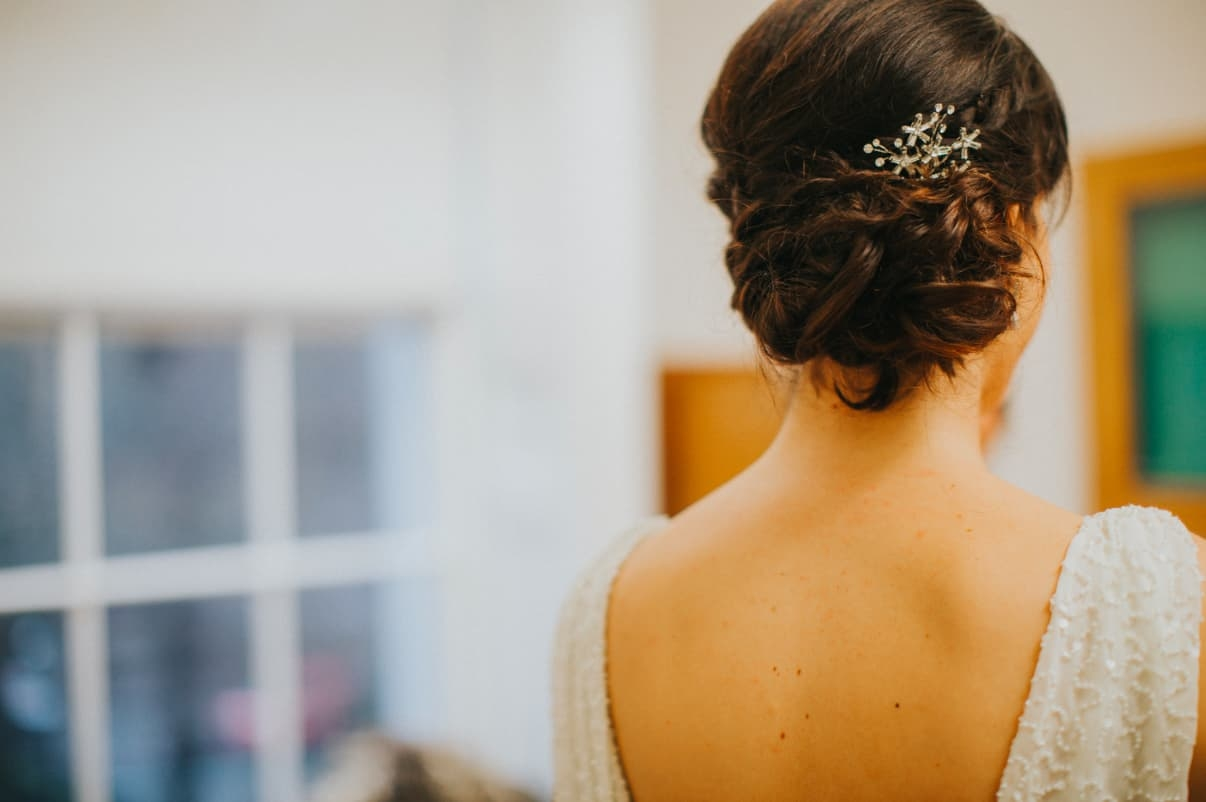 close up of bridal updo with hair accessory