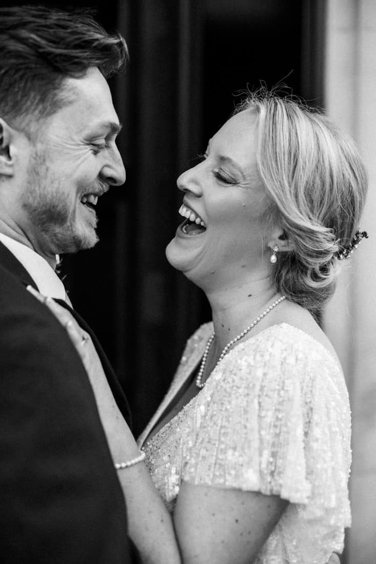 vintage bride and groom laughing
