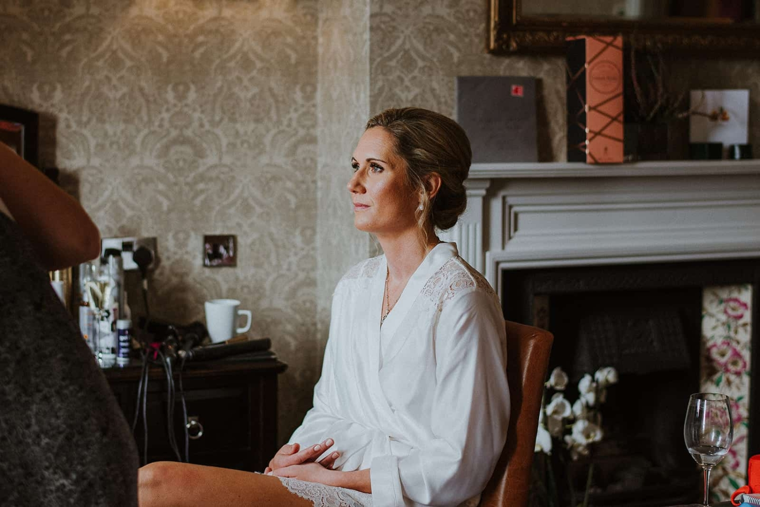 bride in dressing gown with natural glowing makeup