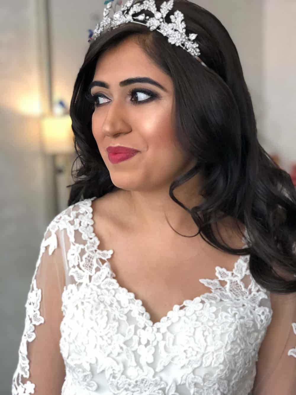 portrait of bride with red lips and tiara