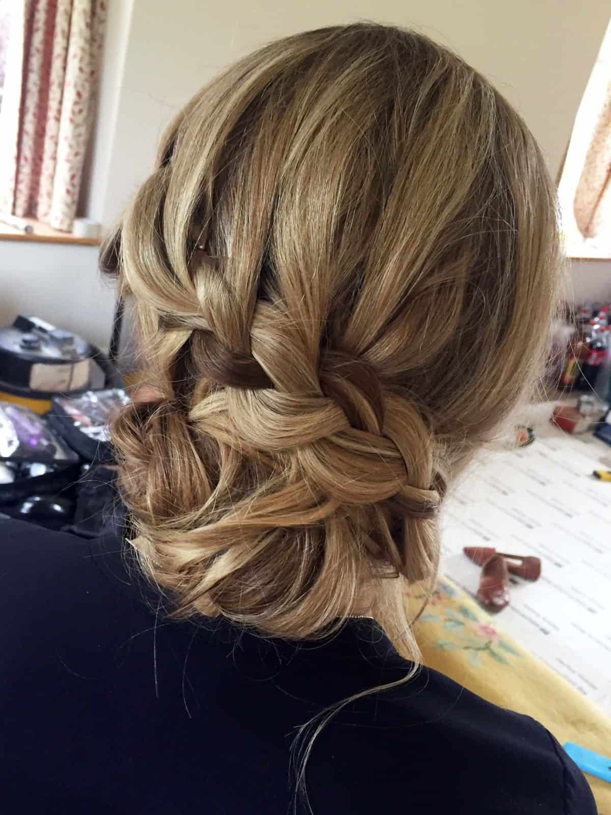 close up on low updo with braid
