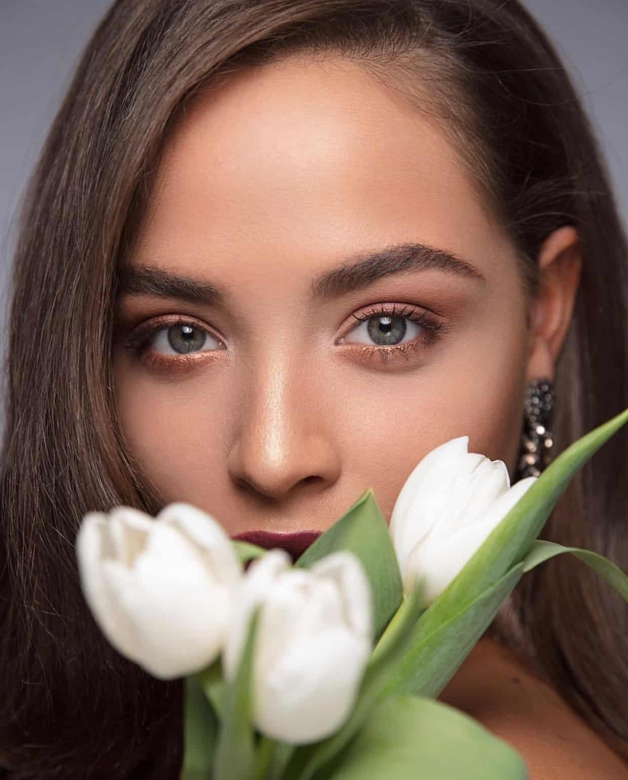 portrait of woman with natural makeup and white tulips
