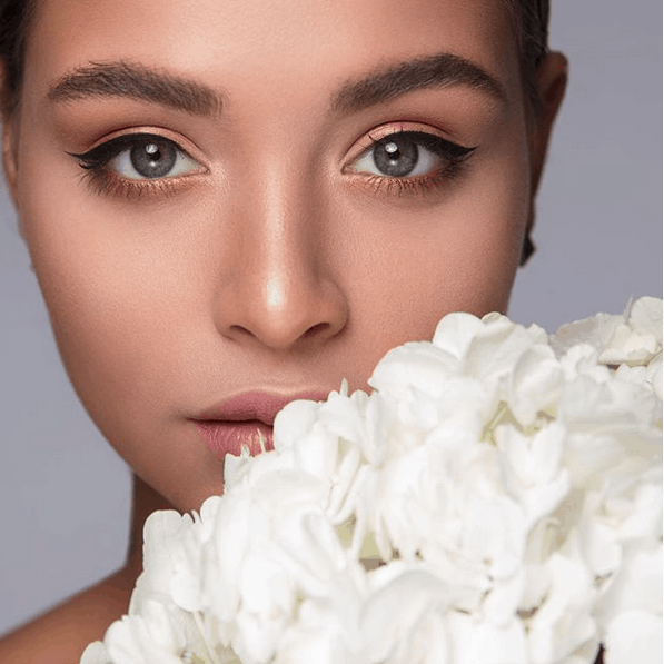 bridal beauty with fresh flowers by wedding hair and makeup artist Becky