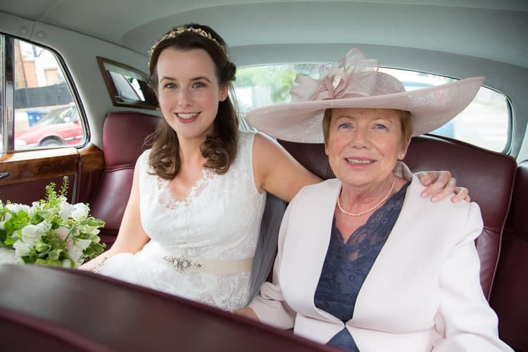 bride and mother of the bride in wedding car
