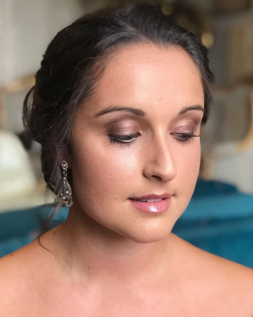 bride with purple eyeshadow by wedding hair and makeup artist Chloe