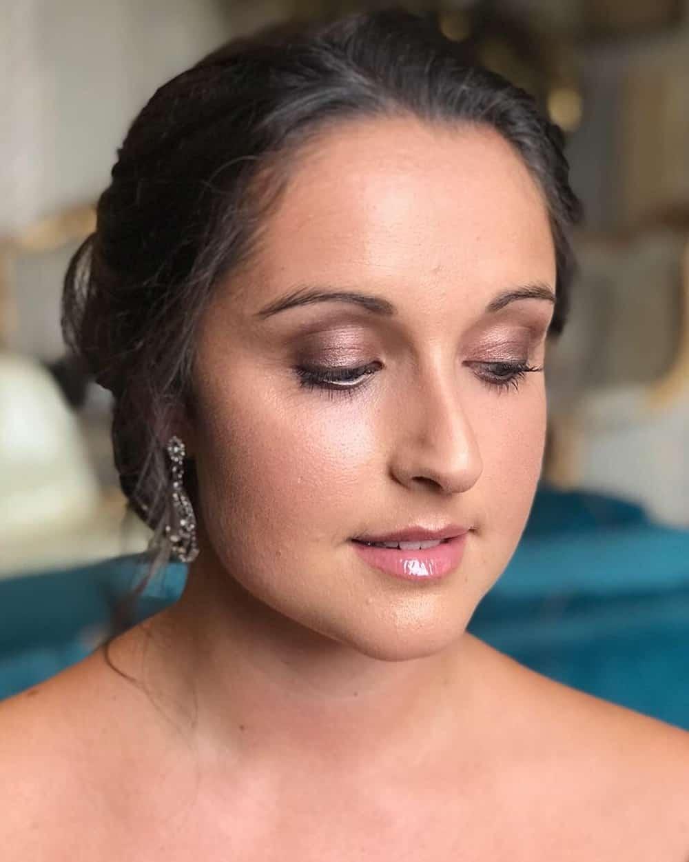 bride with purple eyeshadow by wedding hair and makeup artist Chloe