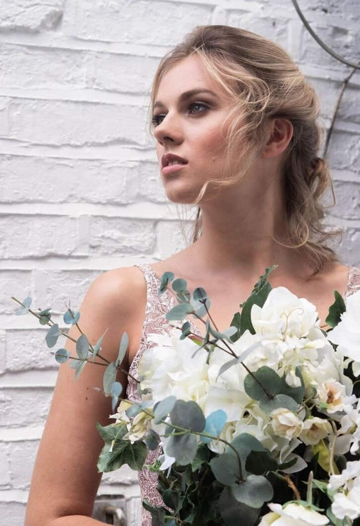 portrait of beautiful bride with loose boho hair and large bouquet