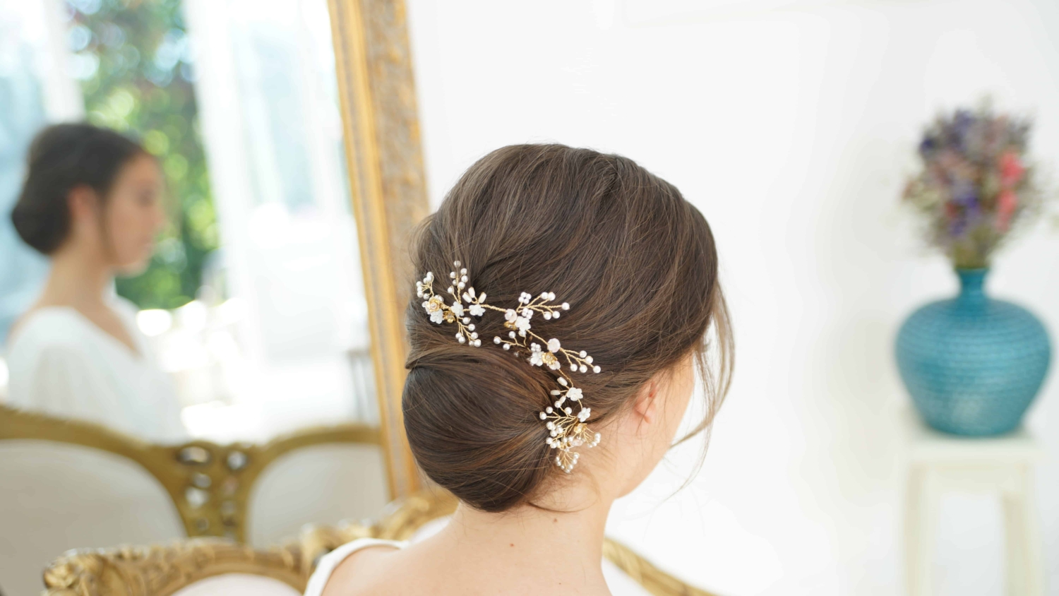 bridal chignon with hair vine