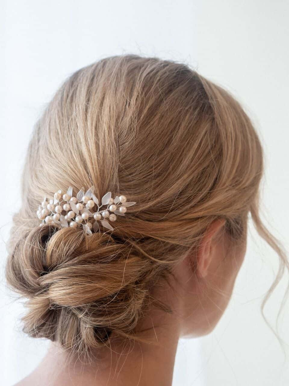 close up of modern bridal updo with hair accessory
