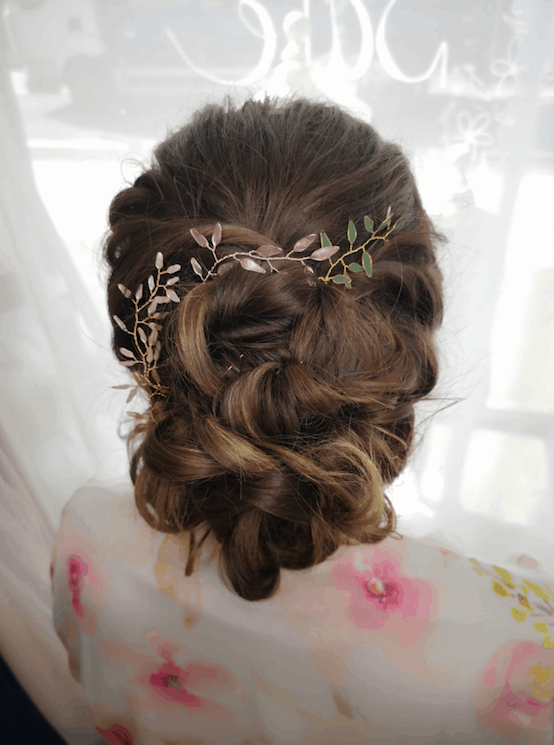 relaxed bridal updo with hair vine