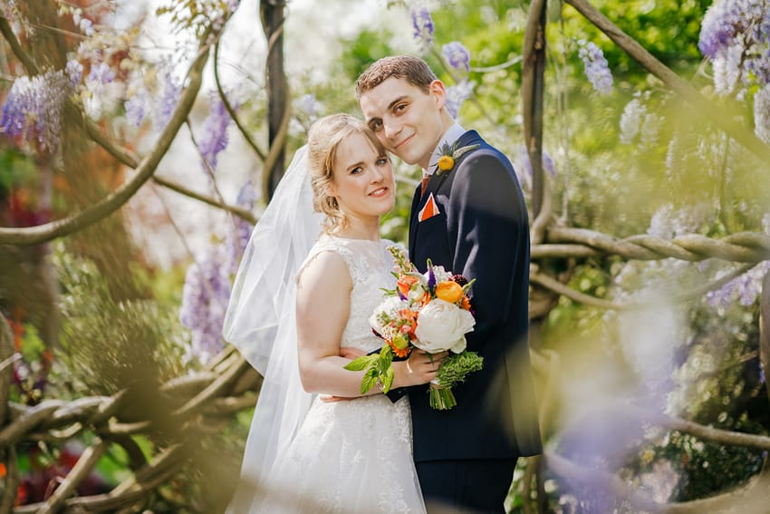 happy couple on wedding day surrounded by trees