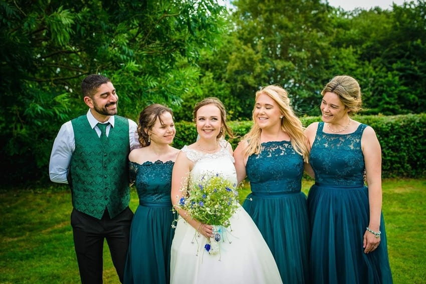 photograph of happy bridal party in garden