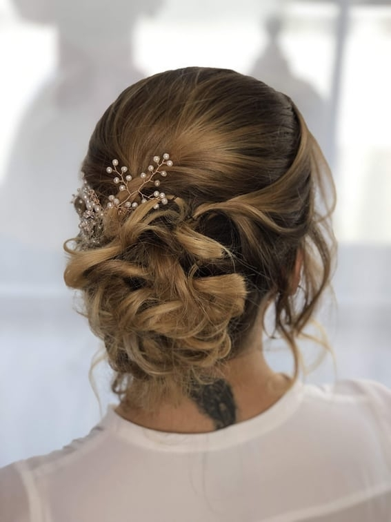 bridal updo with accessory by wedding hair and makeup artist Alice