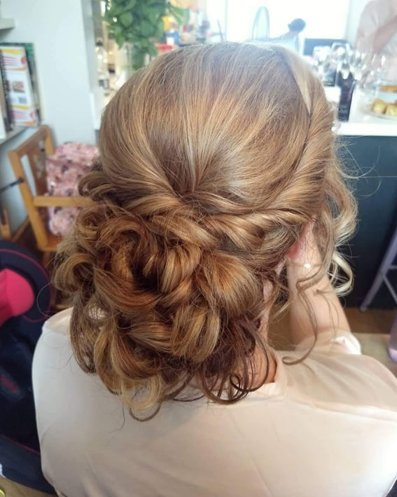 curled bridal updo by wedding hair and makeup artist Alice