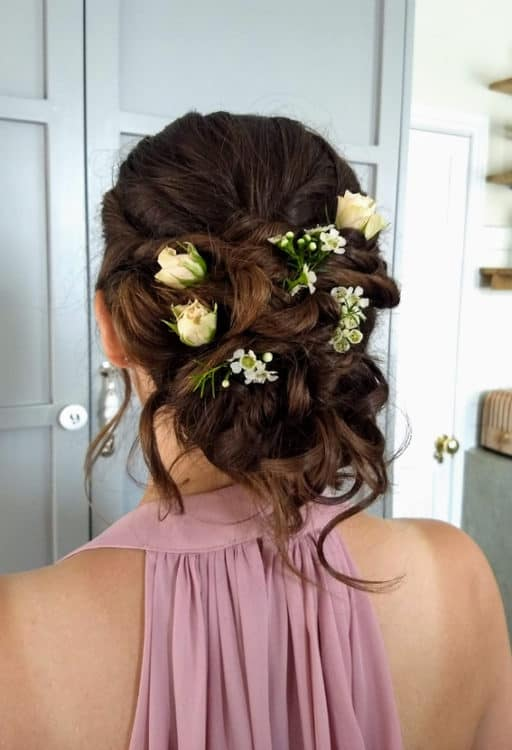 bridesmaid updo with fresh flowers by wedding hair and makeup artist Alice