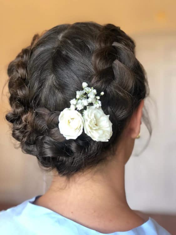 boho braided updo with flowers by wedding hair and makeup artist Alice